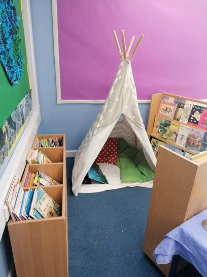 This is our Reading area, you can choose a book to read in the reading teepee!