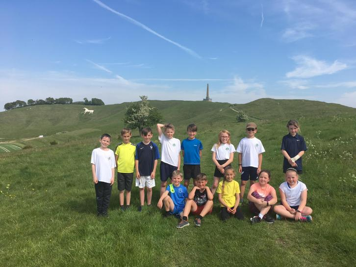 Running Club enjoying the Downs in Summer