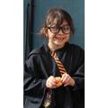 Harry Potter enjoys an orange
