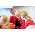 Children using technology to assist their learning