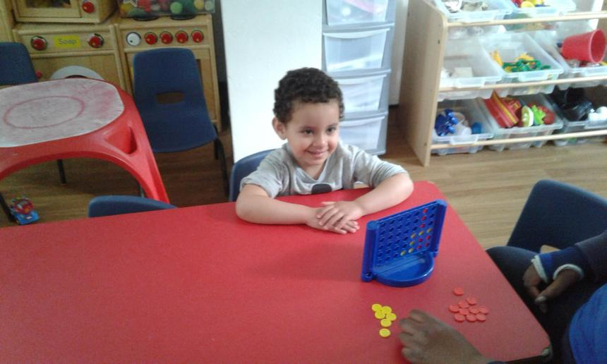 Connect four! Seeks out companionship with adults and other children, sharing experience.