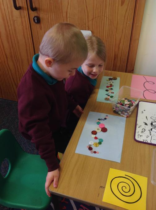 Button patterns in our finger gym area - to strengthen our muscles for writing.
