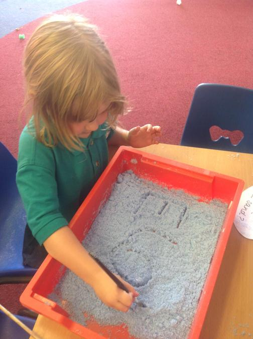 Practicing our names in sensory sand.