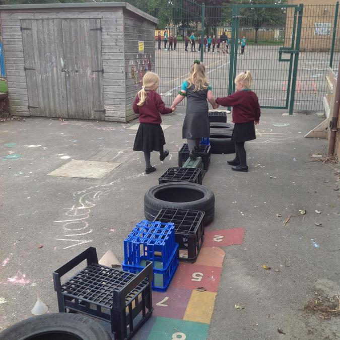 Taking turns and helping each other on the tricky bits of the obstacle course.