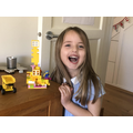 Showing off her creative skills in making a house for Lucy and Emmett from the Lego Movie.