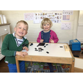 Siblings working together and looking very happy in their lovely learning space :)