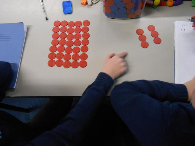 Using counters to make arrays and solve problems