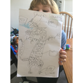 Great work labelling a dragon! Well done for using your sounds :)