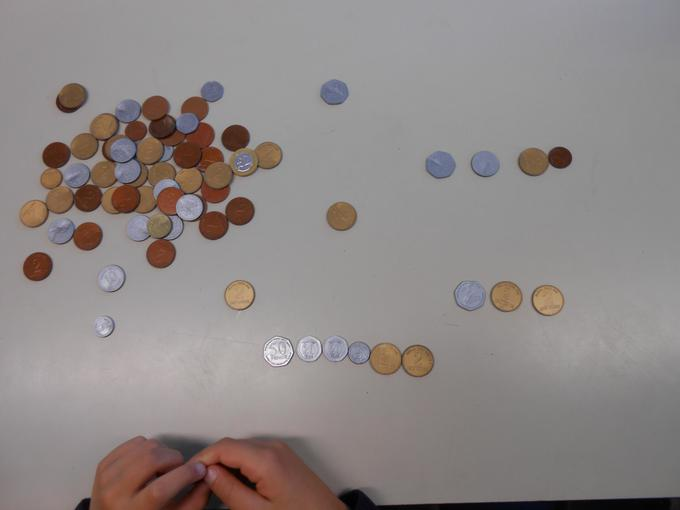 Using coins to solve money related problems
