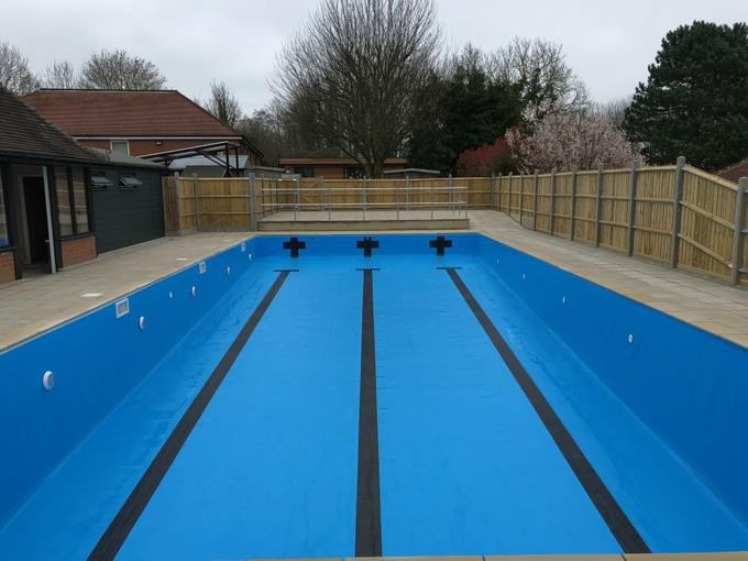 New pool liner and surrounding walk ways