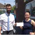 Robert from Noah Enterprise collecting the cheque