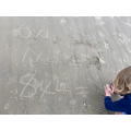Joseph doing times tables in the sand. Great idea!