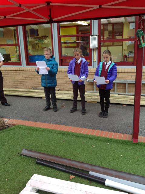 Pupils from Year 5 read poems and Mr Pask played his trumpet marking our 2 minutes silenc