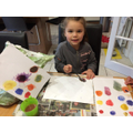 Marnie enjoying exploring colour mixing