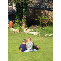 Beau read to his brother in the garden