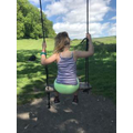 Amelie swinging at the Cerne Giant