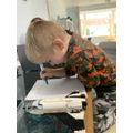 Elijah working very hard!