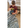 Harrison chilling with a book and a frog of course!