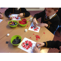 Working hard on our poppies.
