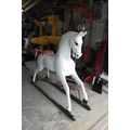 The rocking horse is painted white.