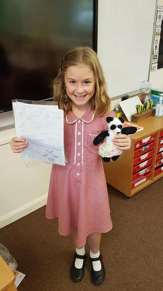 Emily created a panda bear from scratch, and knitted a lovely skirt for the panda.