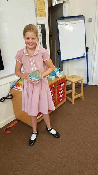 Sienna was inspired by her holidays to paint a stone with our values.
