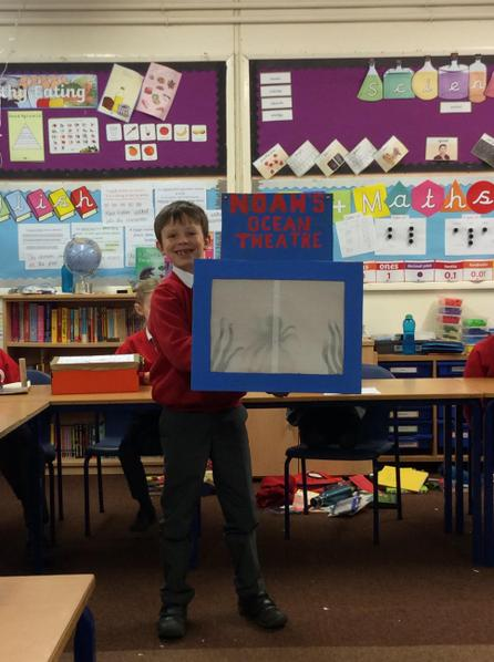 Noah created shadow puppets to show how light and shadows work.