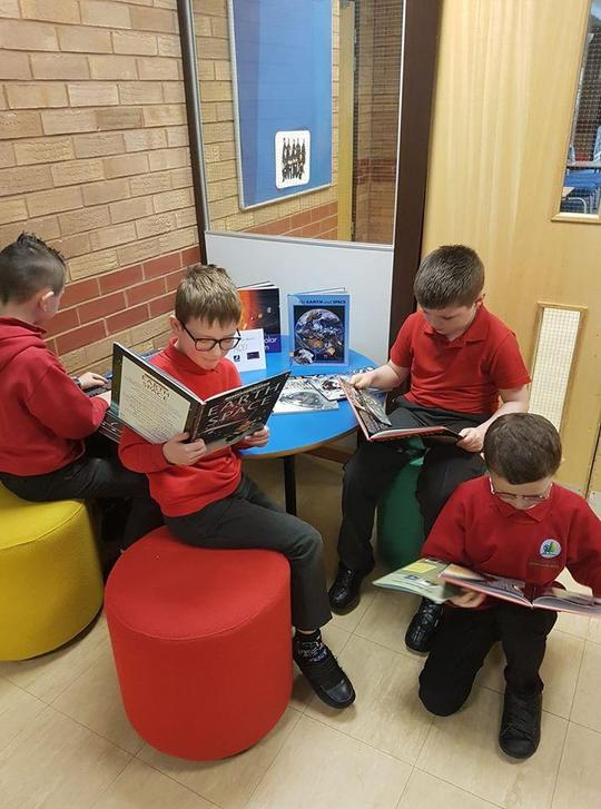 Children finding out more about space in one of our reading areas.