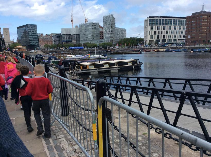 Past the barges which tell of Liverpool's history