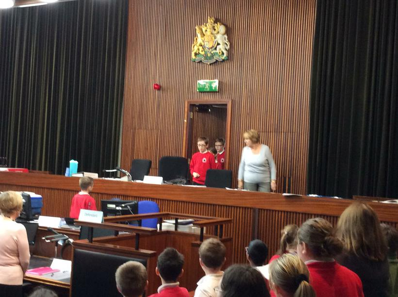 Magistrates enter from their chambers