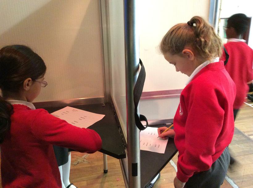 Girls using their vote