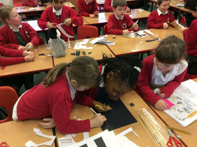 Working as a team to design our puppets.