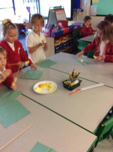 Next we put fruit on the sticks.