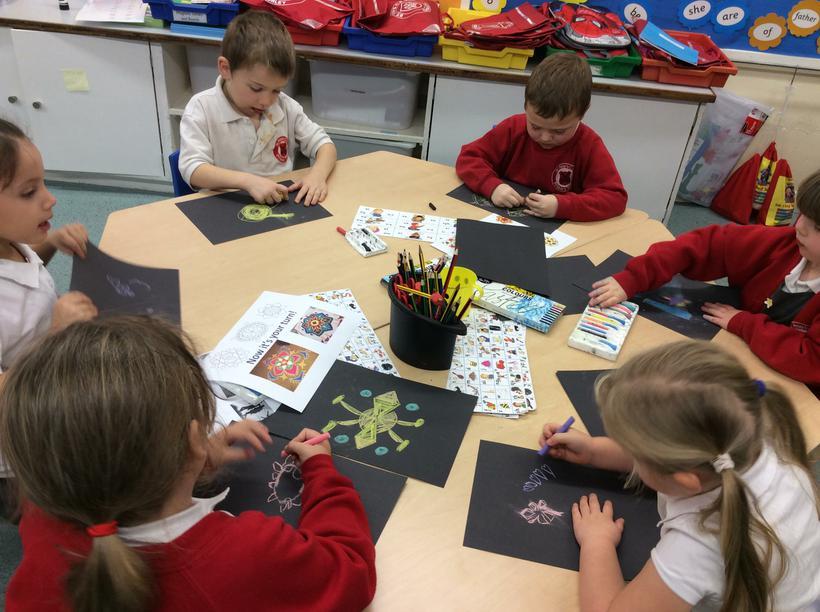 We used chalk to draw rangoli patterns.