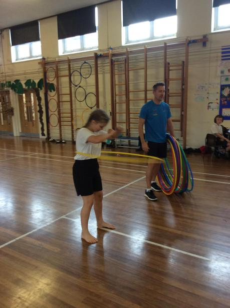 Courtney showing us how to hoola hoop
