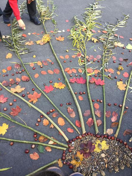 Central pattern with conkers and cherry stones
