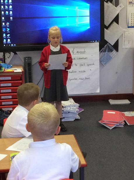 Presenting our manifestos to the whole class.