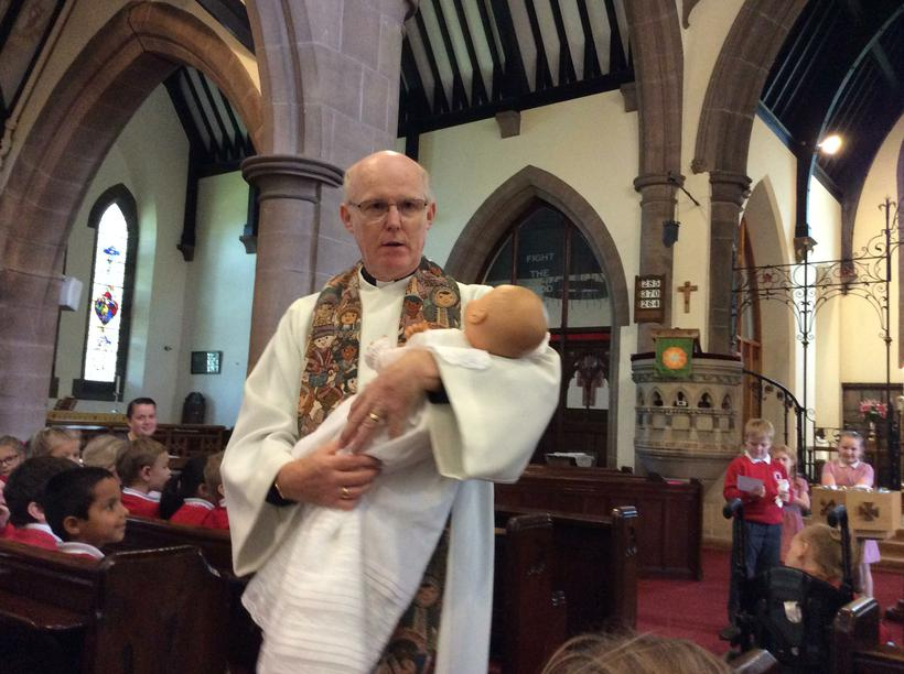 The congregation welcomed the baby.