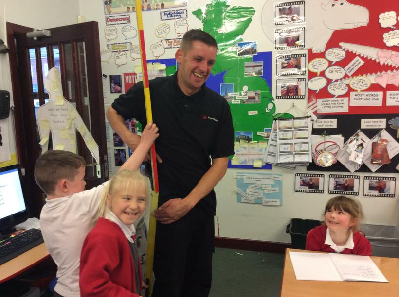 Measuring Mr Wilson's leg length.