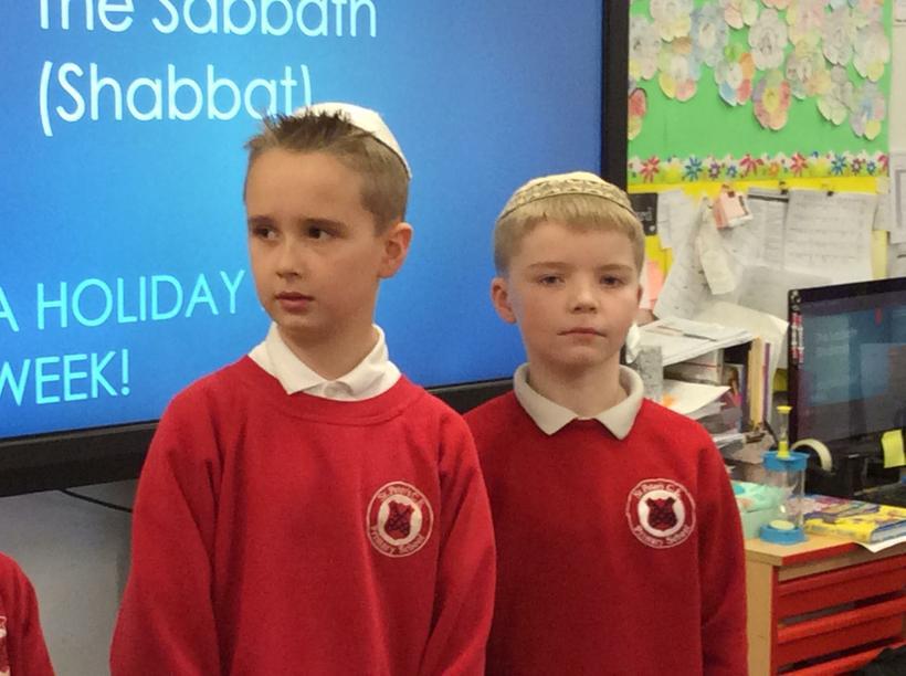 Jewish boys wear a kippar