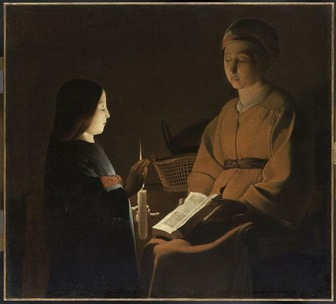 Artist uses candlelight to illuminate the Bible