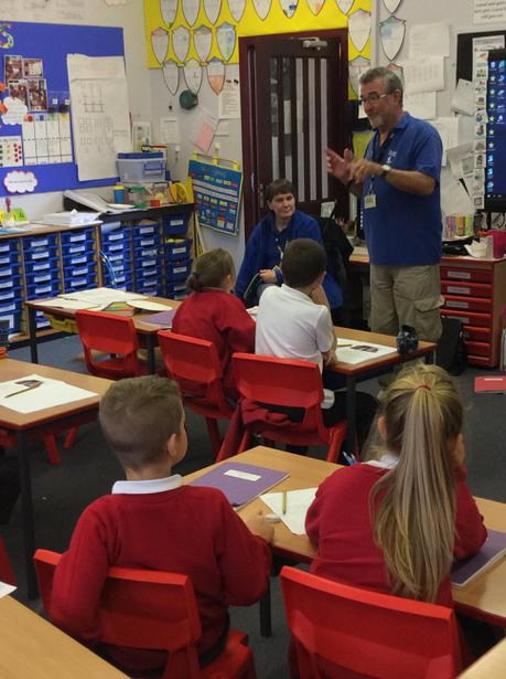 Dave spoke to class 8 about puppy walking.