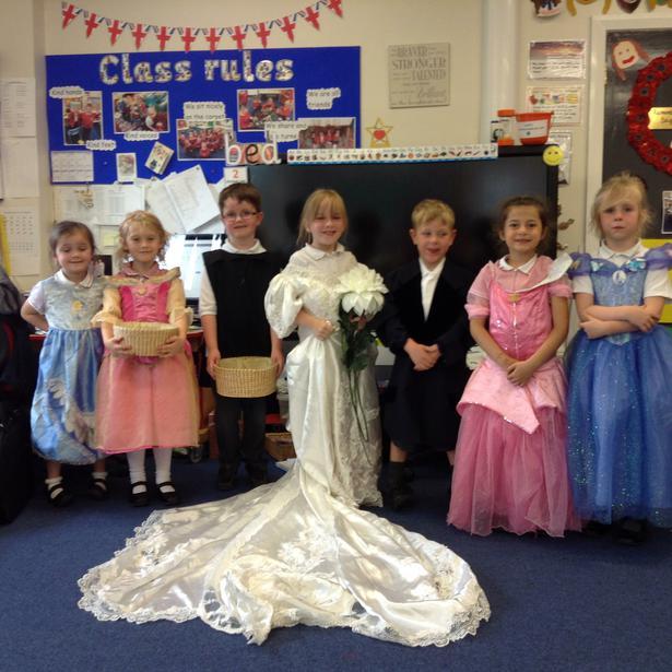Bride, groom, bridesmaids, page boy, flower girl