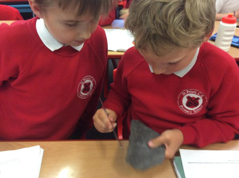 We scratched to test a rocks hardness.