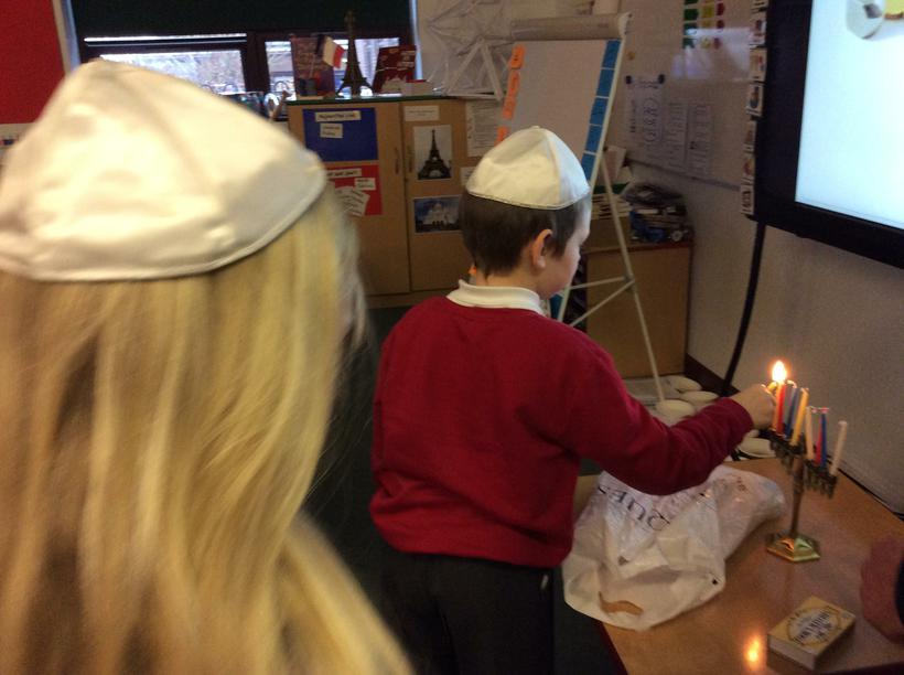 Wearing a Jewish kippah.