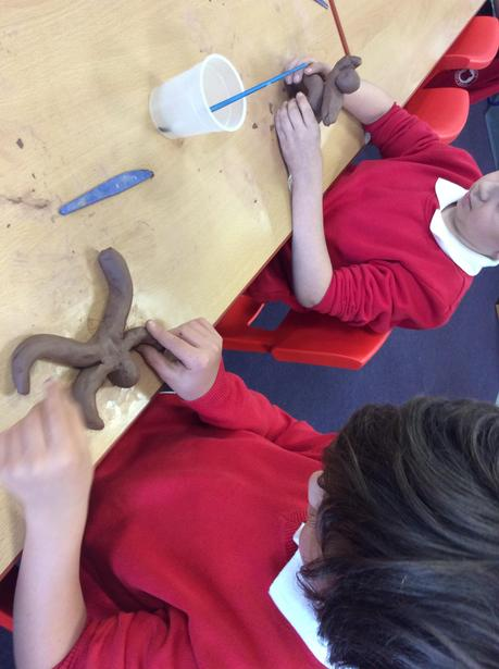 Sculpting a clay figure