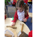 Making different length worms with playdough
