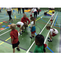 Mrs Beviss, Sports Coach, helping the children.