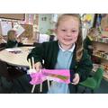 Lola made a sock puppet caterpillar