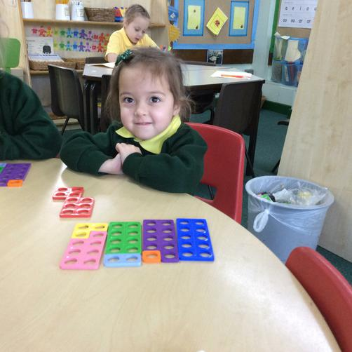 Making number bonds to 10 using numicon.